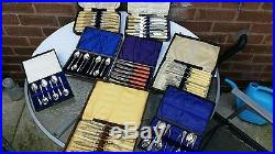 A collection of 8 vintage boxes of silver plate cutlery