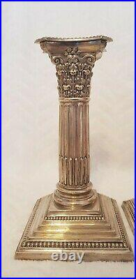Antique Silver plated Weighted Pair Of Corinthian Column Candlesticks